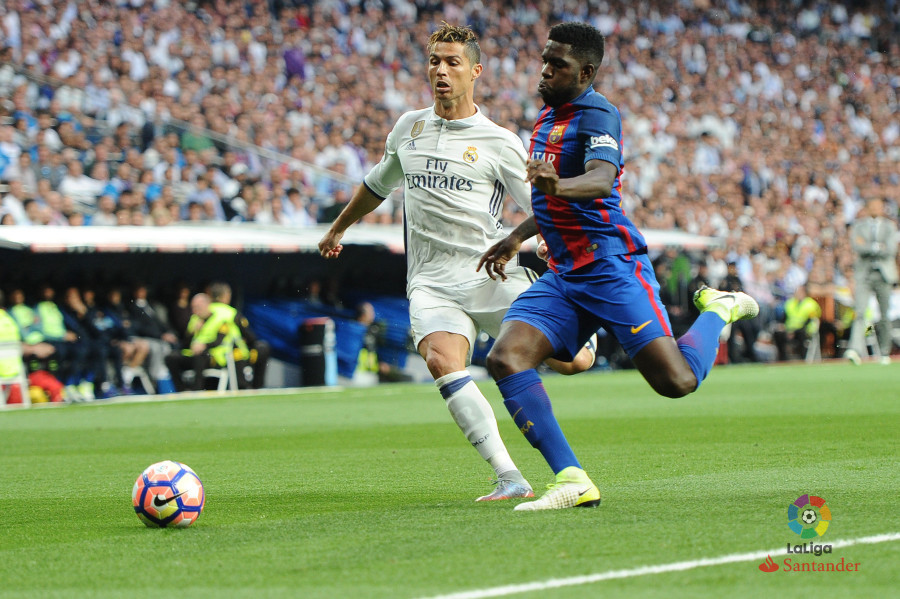 (l) of real madrid is tackled by ivan gonzalez of malaga during the la liga match between real madrid